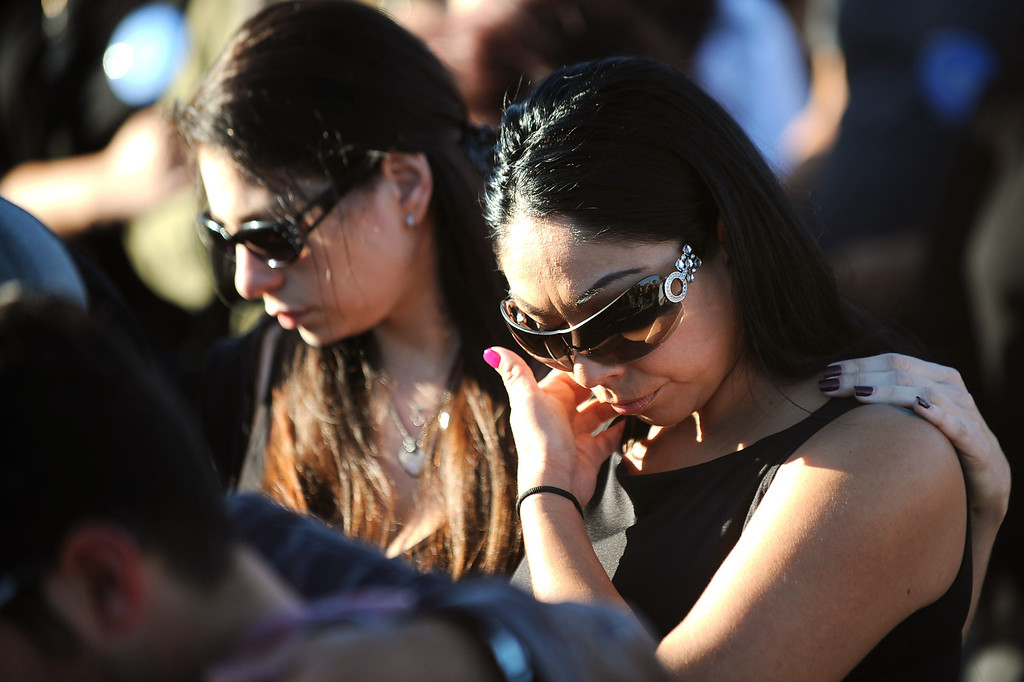 . Mourners gather for a vigil at Santa Monica College Monday, June 10, 2013.(Andy Holzman/Los Angeles Daily News)