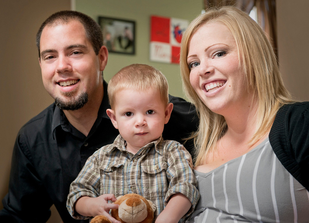 . Carson Nicholas Smyth is a 20-month-old toddler getting ready for his third heart surgery to repair a congenital heart defect.  He had his first heart surgery at three days old and now he\'s going to be traveling to Boston Children\'s Hospital in October with his parents, Nick Smyth and Rheanna White, pictured at their Glendora home August 21, 2013.   (SGVN/Staff photo by Leo Jarzomb)