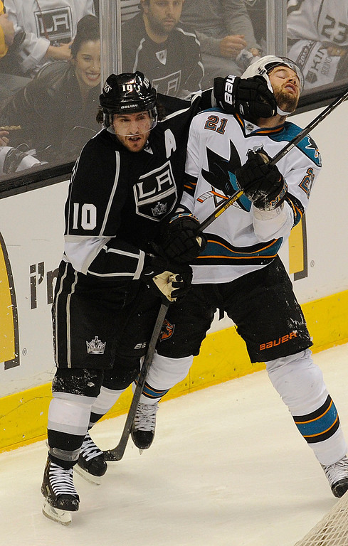 . Kings#10 Mike Richards and Sharks#21 JT Galiardi mix it up in the first period. The Kings played the San Jose Sharks during the first game in the Second Round of the Western Conference Playoffs. Los Angeles CA 5/14/2013(John McCoy/LA Daily News)