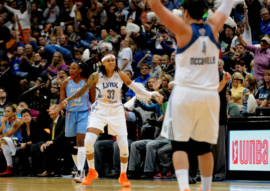 . Minnesota\'s Seimone Augustus (33) celebrates after drawing a foul during the third quarter against the Atlanta Dream in Game 1 of the WNBA Finals on Oct. 6, 2013, at Target Center in Minneapolis. (Pioneer Press: Sherri LaRose-Chiglo)