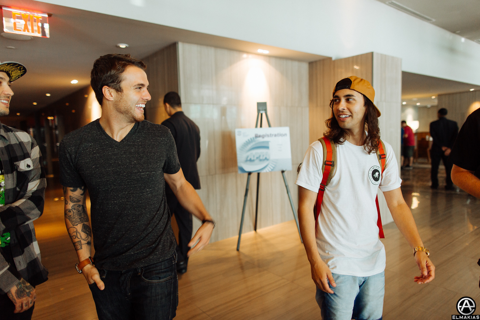 Rian Dawson of All Time Low and Vic Fuentes of Pierce The Veil getting ready to hug it out