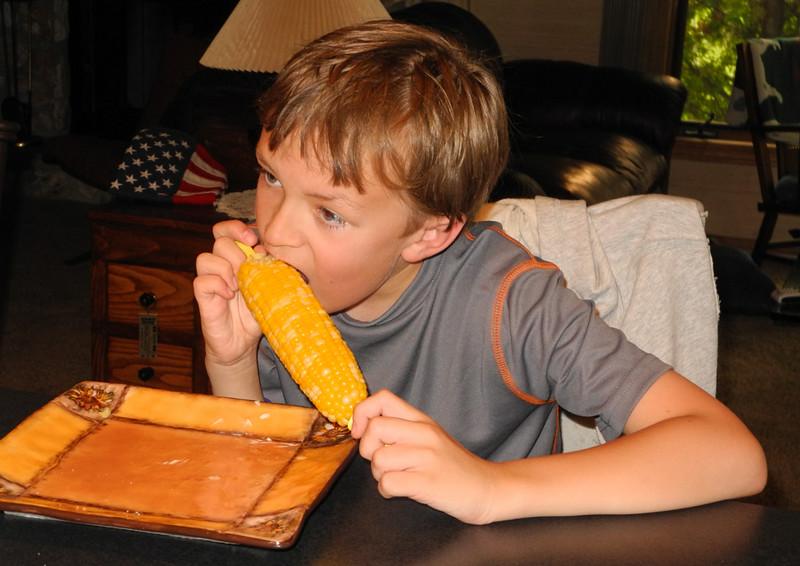 Eating sweet corn at dinner.