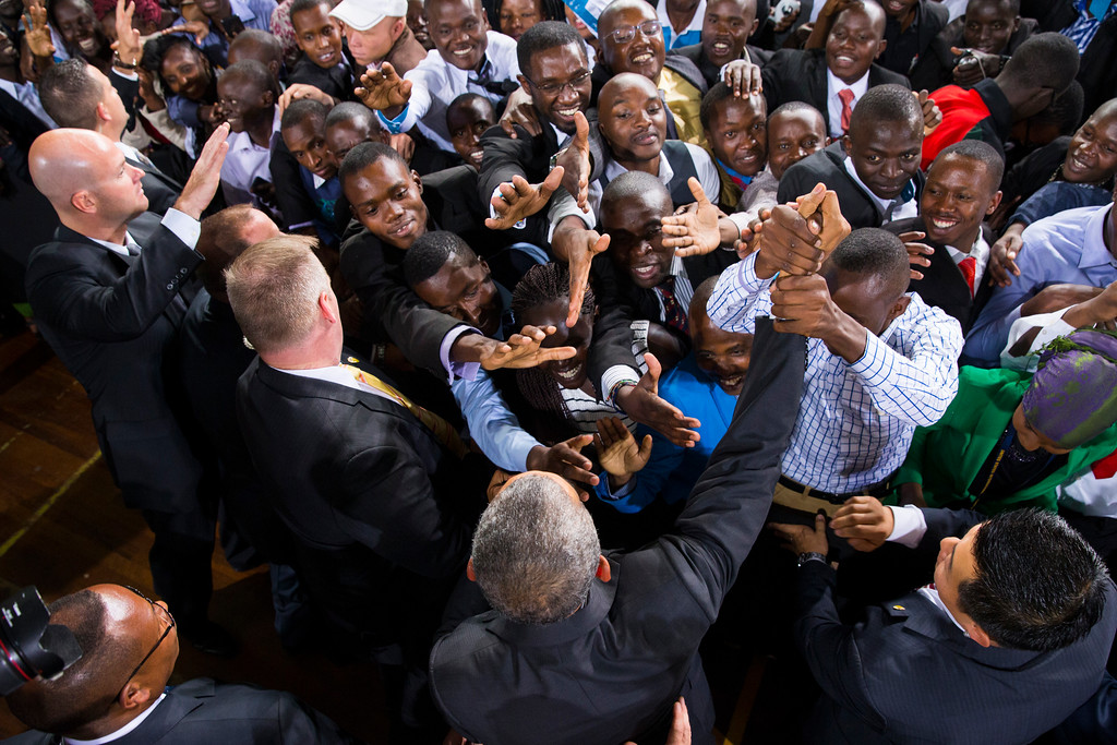 . President Barack Obama, bottom center, shakes hands after delivering a speech at Safaricom Indoor Arena, Sunday, July 26, 2015, in Nairobi. On the final day of his visit in Kenya, Obama laid out his vision for Kenya\'s future, and broad themes of U.S.-Kenya relations. (AP Photo/Evan Vucci)