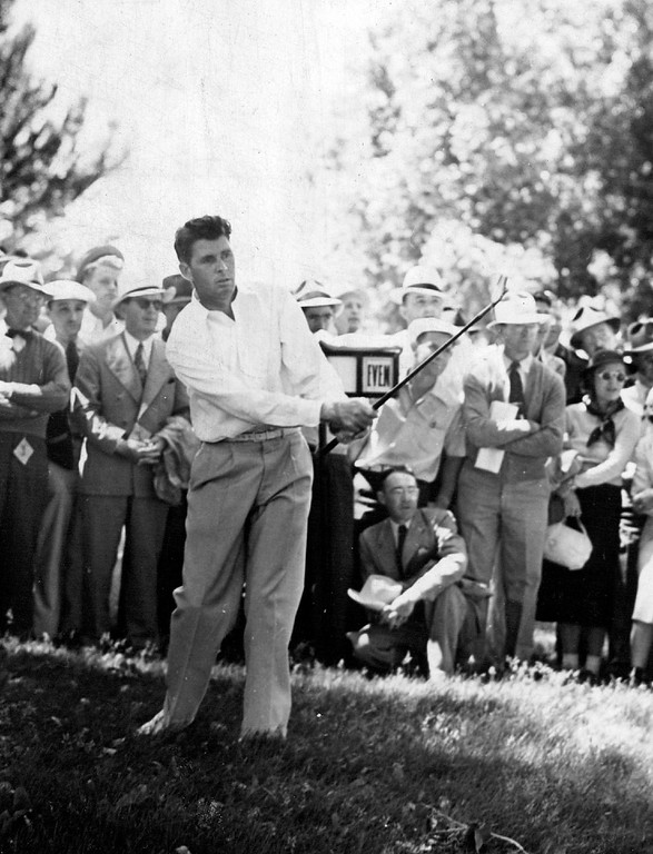 . After setting the pace for two successive days in the National Open at Denver, Henry Picard of Hershey, PA. ran into difficulty on the fourth, among other places, where his ball got into the alfalfa, and Is shown trying to get out. He Finished With 77. Denver Post Library photo archive