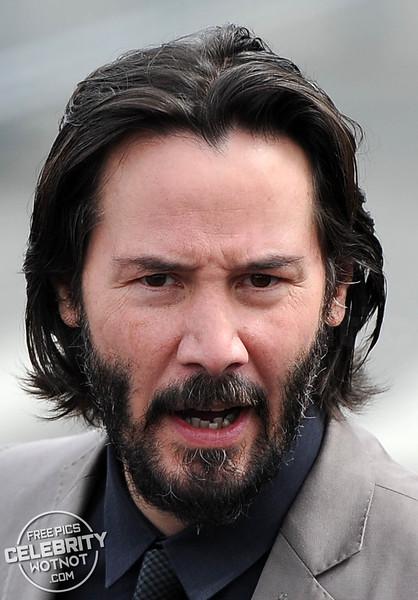 Keanu Reeves Shows Off Salt and Pepper Beard In Smart Suit, LA
