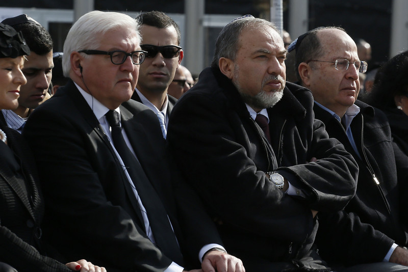 . From L to R: German Foreign Minister Frank-Walter Steinmeier (L), Israel\'s Foreign Minister Avigdor Lieberman and Defence Minister Moshe Yalon attend a state memorial service for the Jewish state\'s former premier Ariel Sharon at the Knesset (Israeli Parliament) in Jerusalem on January 13, 2014, as Israel was burying one of its most skilled but controversial political and military leaders who was hailed internationally for his tireless dedication to the Jewish state. Sharon died at the age of 85 following eight years in a coma. (GALI TIBBON/AFP/Getty Images)