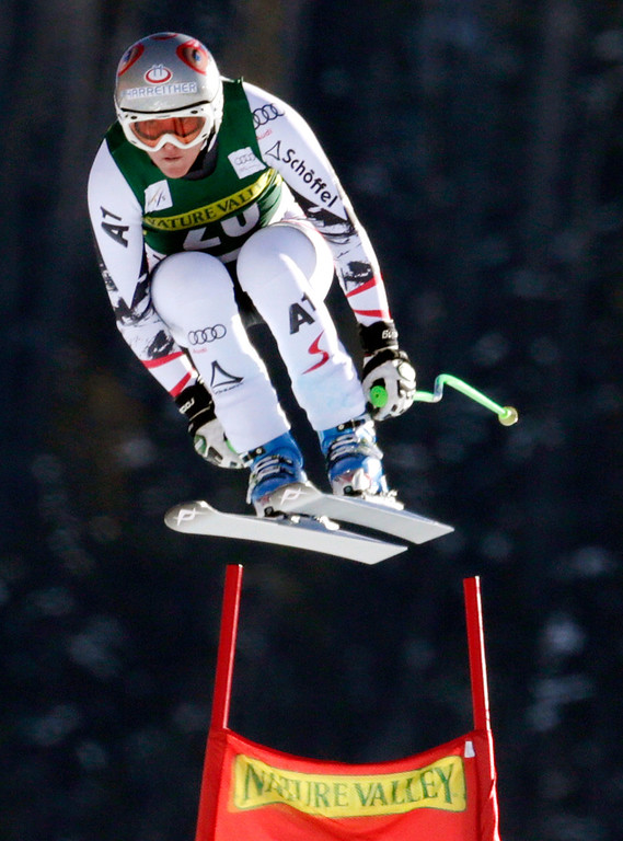 . Austria\'s Andrea Fischbacher flies off the last jump during the women\'s World Cup Downhill skiing event Friday, Nov. 29, 2013, in Beaver Creek, Colo. (AP Photo/Charles Krupa)