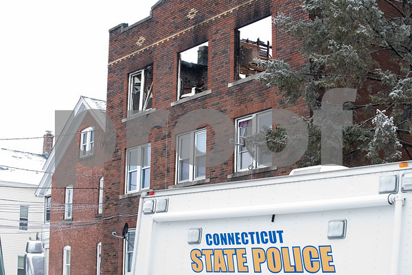 01/17/18 Wesley Bunnell | Staff The New Britain Fire Department battled a structure fire at 42 Connerton St. starting late on Tuesday night and continued into Wednesday morning. The building sustained severe damage with with interior structural collapse and a total roof collapse. One firefighter was injured and transported to the hospital for observation and released. Parts of the collapsed roof can be seen through the top windows.