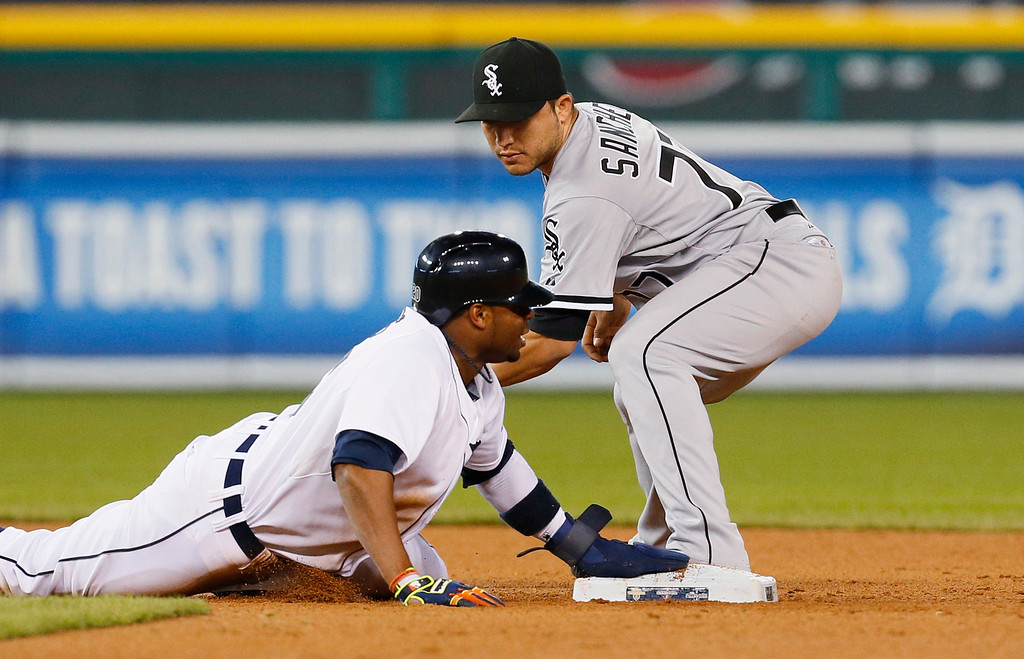 . Detroit Tigers left fielder Rajai Davis dives back into second base safely under the tag of Chicago White Sox shortstop Carlos Sanchez in the seventh inning of a baseball game in Detroit Tuesday, Sept. 23, 2014. (AP Photo/Paul Sancya)