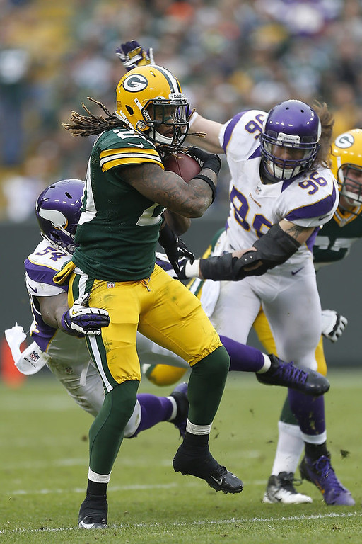 . Alex Green #20 of the Green Bay Packers is tackled by Jasper Brinkley #54 of the Minnesota Vikings at Lambeau Field on December 2, 2012 in Green Bay, Wisconsin.  The Packers defeated the Vikings 23-14.  (Photo by Wesley Hitt/Getty Images)