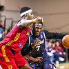 The Red Claws' Jason Calliste drives the lane guarded by the Mad Ants' C.J. Fair.