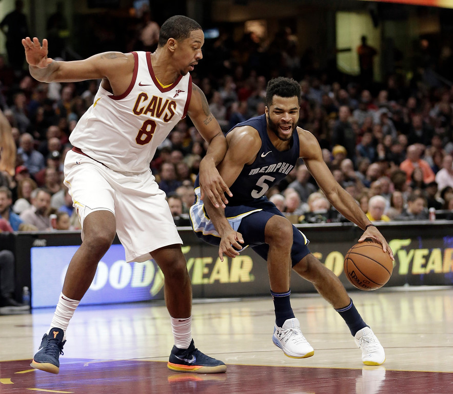 . Memphis Grizzlies\' Andrew Harrison (5) drives against Cleveland Cavaliers\' Channing Frye (8) in the second half of an NBA basketball game, Saturday, Dec. 2, 2017, in Cleveland. (AP Photo/Tony Dejak)