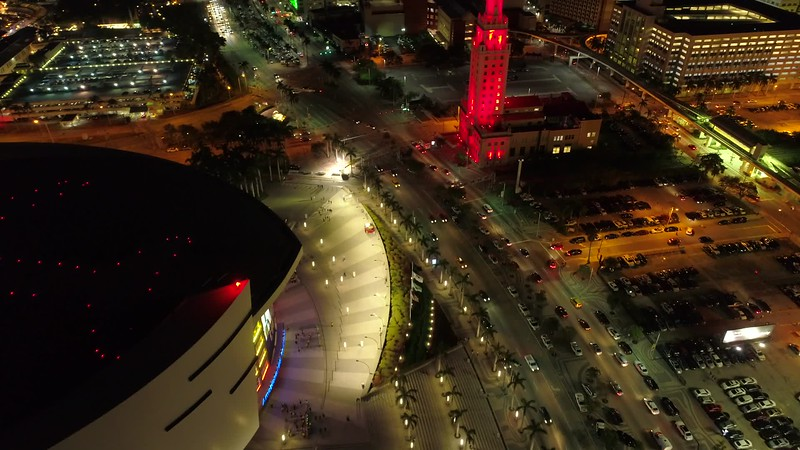 Aerial tilt up reveal Downtown Miami at night