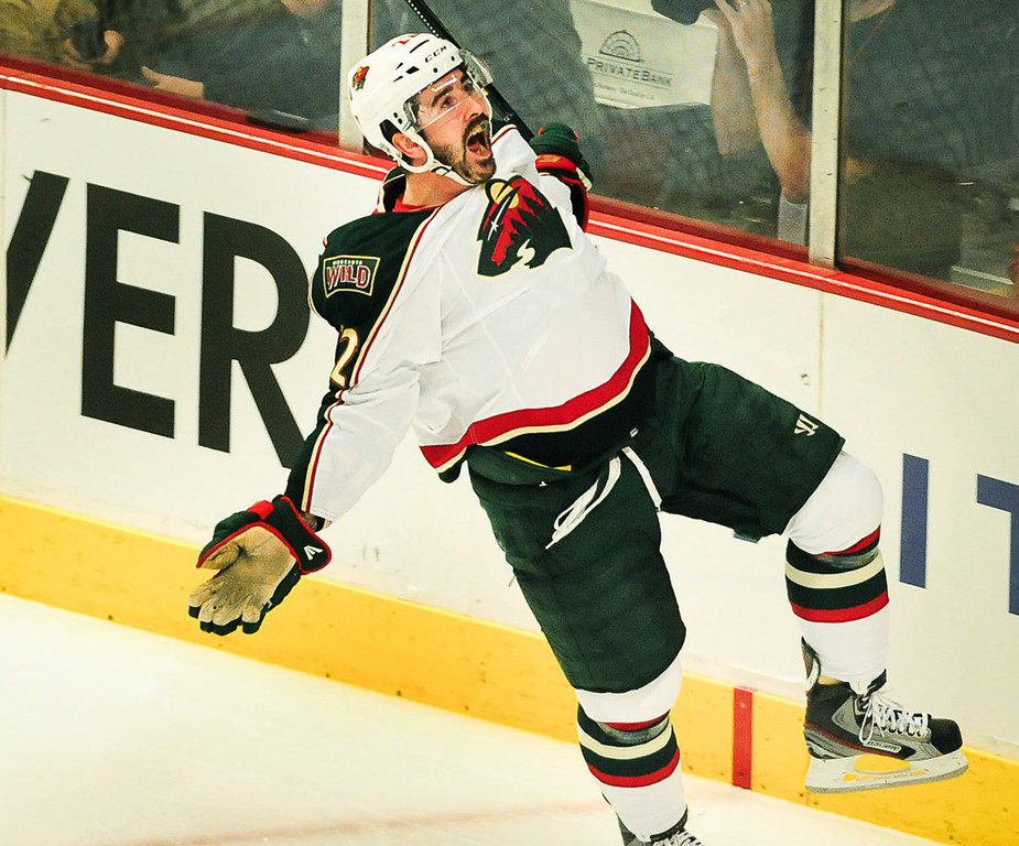. Minnesota right winger Cal Clutterbuck reacts after scoring the game\'s first goal in the first period.   (Pioneer Press: Ben Garvin)