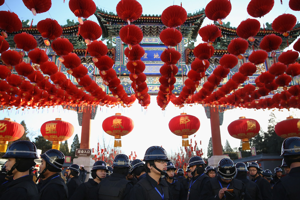 . Security personnel line up before the opening ceremony of the Spring Festival Temple Fair at the Temple of Earth park on January 30, 2014 in Beijing, China.  (Photo by Feng Li/Getty Images)