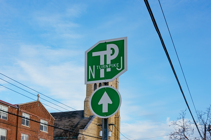 New Jersey Turnpike sign on Avenue E in Constable Hook, Bayonne, New Jersey on November 26, 2016.  Photographed with a Fujifilm X-Pro2 and XF27mmF2.8 lens at 27 mm and  1/640 sec | ƒ / 5.6| ISO 200.  © Victoria and Michael Mroczek  R:\RAW\2016\11\11-26-16 Scarlett's First Walk\11262016-Scarlett-First-Walk-Mroczek-6.RAF