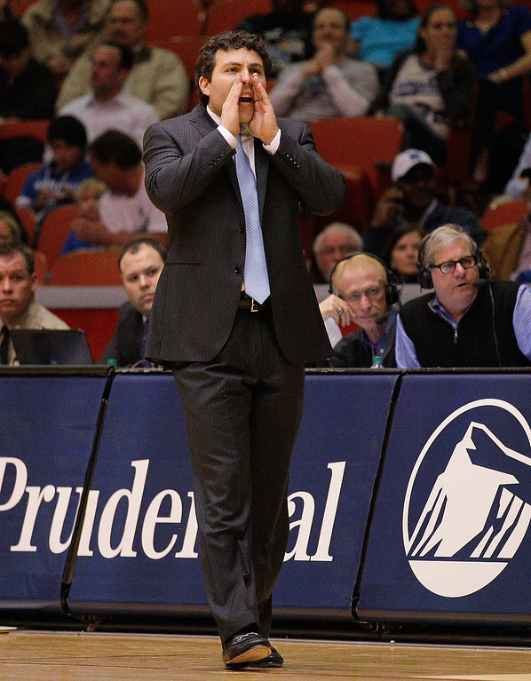 . Memphis head coach Josh Pastner calls out a play late in the against  Houston during the second half of an NCAA college basketball game, Thursday, Feb. 27, 2014, in Houston. Houston won 77-68. (AP Photo/Bob Levey)