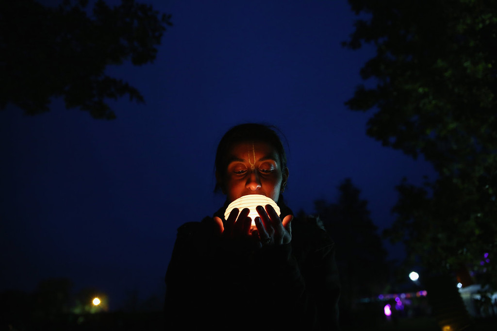 . A woman holds a lantern during Diwali celebrations at Bhaktivedanta Manor on November 3, 2013 in Watford, United Kingdom. The festival is an opportunity for Hindus to honour Lakshmi, the goddess of wealth and other gods. Leicester\'s celebrations are one of the biggest in the world outside India.  (Photo by Dan Kitwood/Getty Images)