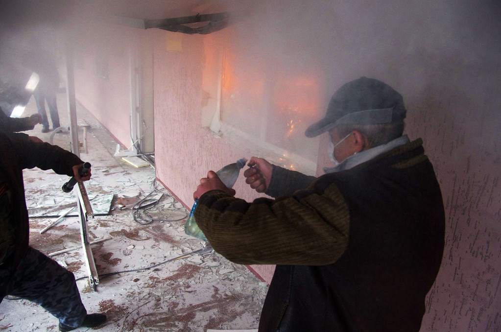 . A pro-Russia protester lights a molotov cocktail during the storming of the regional police building in the eastern Ukrainian city of Horlivka (Gorlovka), near Donetsk, on April 14, 2014.   AFP PHOTO/ ALEXEY  KRAVTSOV/AFP/Getty Images