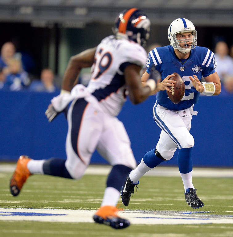 . Indianapolis Colts quarterback Andrew Luck (12) scrambles out of the pocket as Denver Broncos outside linebacker Danny Trevathan (59) chases him during the first quarter October 20, 2013 at Lucas Oil Field. Photo by John Leyba/The Denver Post)