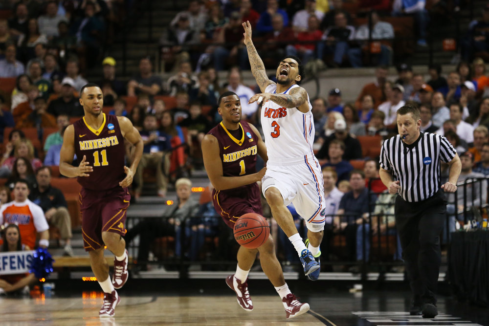 . Andre Hollins #1 of the Minnesota Golden Gophers fouls Mike Rosario #3 of the Florida Gators in the first half during the third round of the 2013 NCAA Men\'s Basketball Tournament at The Frank Erwin Center on March 24, 2013 in Austin, Texas.  (Photo by Ronald Martinez/Getty Images)