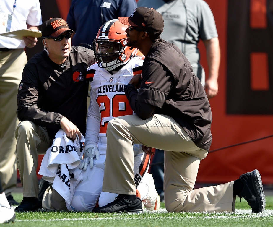 . Cleveland Browns running back Duke Johnson (29) is helped on the sidelines after an injury during the second half of an NFL football game against the Pittsburgh Steelers, Sunday, Sept. 10, 2017, in Cleveland. (AP Photo/David Richard)