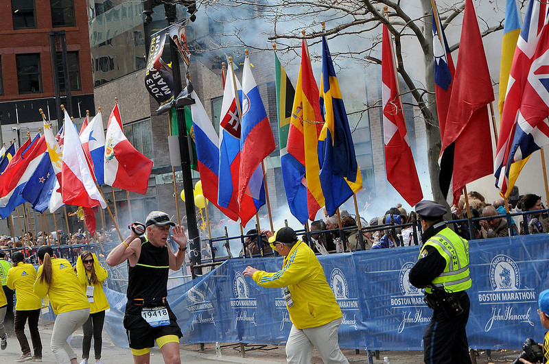. Police and runners react to an explosion during the Boston Marathon in Boston, Massachusetts, April 15, 2013. Two simultaneous explosions ripped through the crowd at the finish line of the Boston Marathon on Monday, killing two people and injuring dozens on a day when tens of thousands of people pack the streets to watch the world famous race. REUTERS/MetroWest Daily News/Ken McGagh/Handout