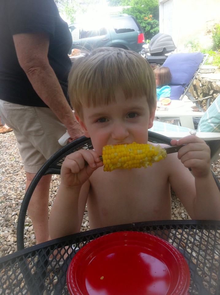 4th of July. Eating corn on the cob for the first time.