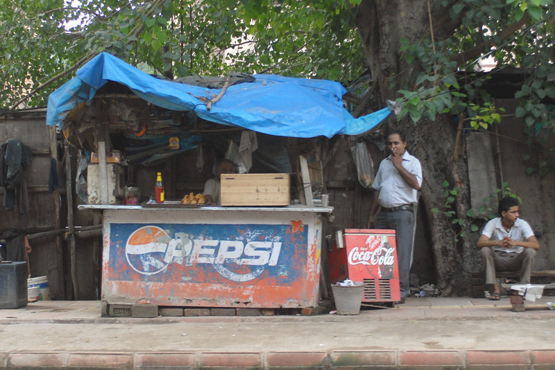 Roadside vendor carries both major brands of soda.