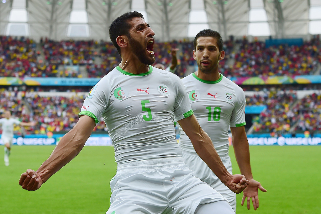 . Algeria\'s defender Rafik Halliche (C) celebrates scoring with Algeria\'s forward Abdelmoumene Djabou (R) during a Group H football match between South Korea and Algeria at the Beira-Rio Stadium in Porto Alegre during the 2014 FIFA World Cup on June 22, 2014.  JUNG YEON-JE/AFP/Getty Images
