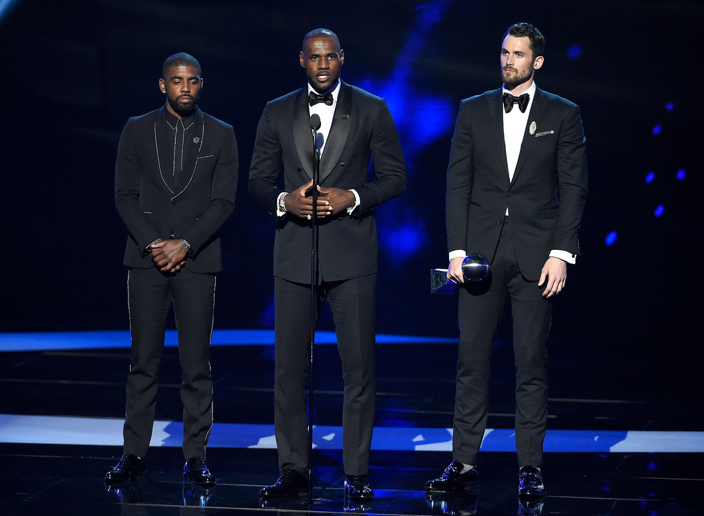 . Cleveland Cavaliers\' Kyrie Irving, from left, LeBron James, and Kevin Love accept the award for best moment for the Cavaliers\' 2016 NBA Finals Championship, at the ESPY Awards at the Microsoft Theater on Wednesday, July 13, 2016, in Los Angeles. (Photo by Chris Pizzello/Invision/AP)