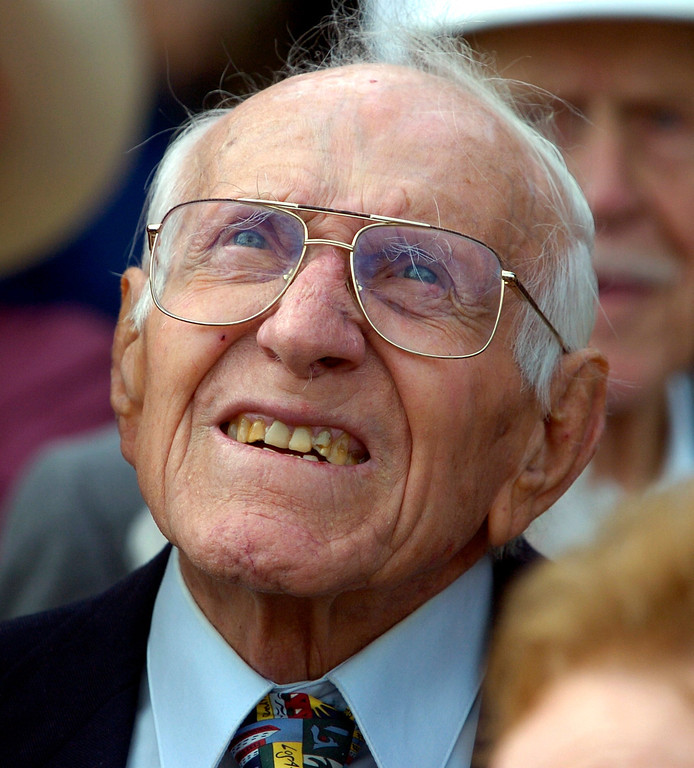 . TORRANCE - 01/27/07 - DAILY BREEZE PHOTO: SCOTT VARLEY - Torrance High and graduate Louis Zamperini celebrate their 90th birthdays Saturday at the school.