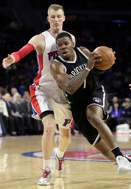 . Brookyn Nets\' Joe Johnson (7) drives to the basket past Detroit Pistons\' Kyle Singler (25) during the first half of an NBA basketball game Saturday, Nov. 1, 2014, in Auburn Hills, Mich. (AP Photo/Duane Burleson)
