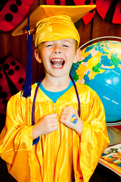 SCHOOL kindergarden excited boy cap n gown (1 of 2).jpg