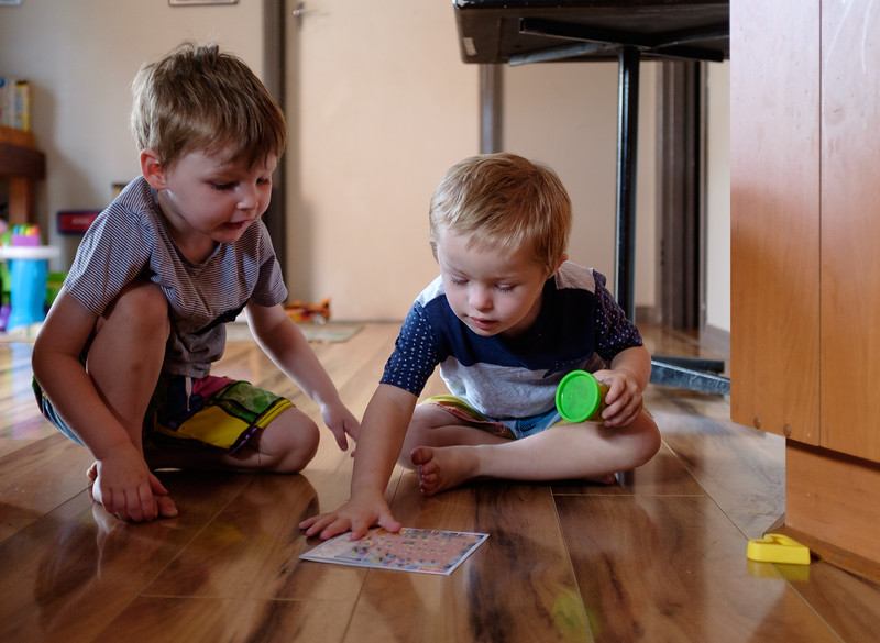 Two Boys Playing on the Floor