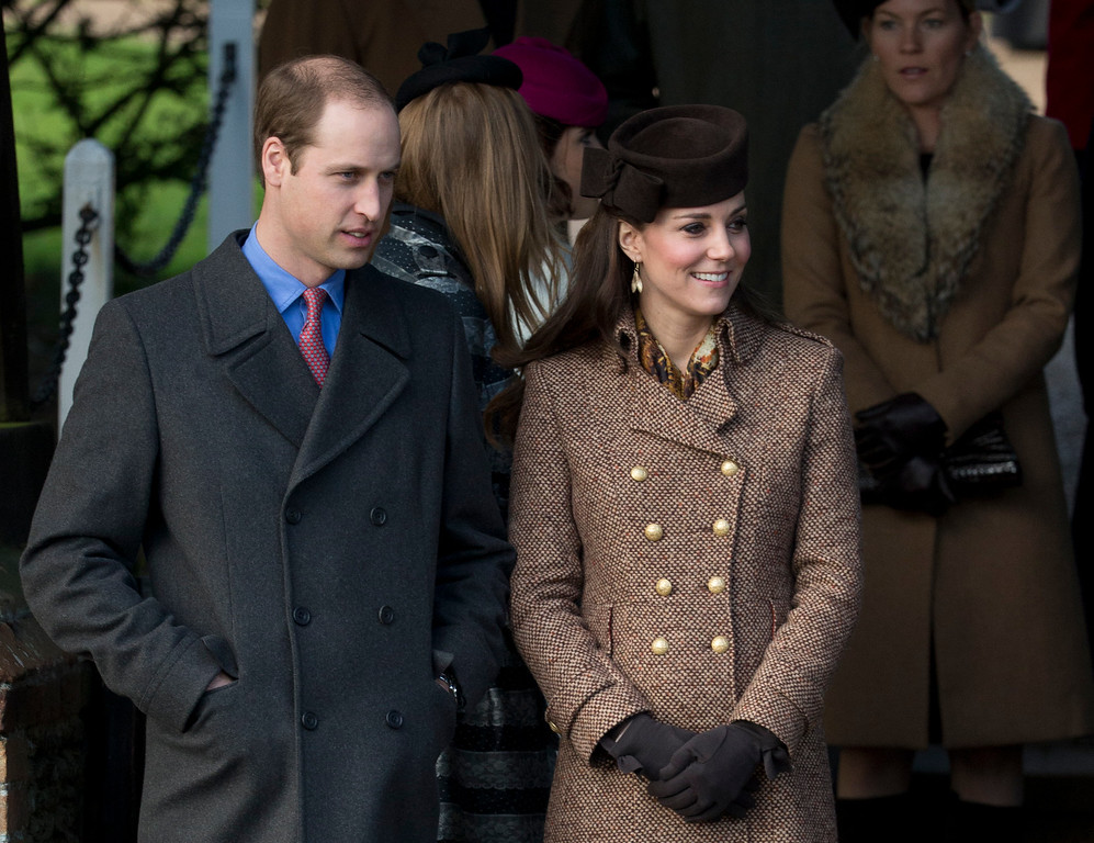. Britain\'s Prince William and his wife Kate Duchess of Cambridge leave after attending the British royal family\'s traditional Christmas Day church service at St. Mary Magdalene Church in Sandringham, England, Thursday, Dec. 25, 2014.  (AP Photo/Matt Dunham)