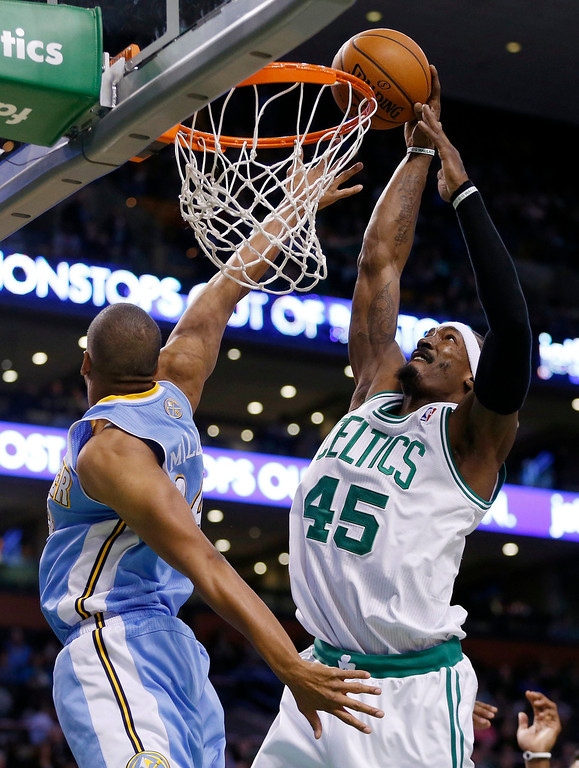 . Boston Celtics\' Gerald Wallace (45) scores against Denver Nuggets\' Andre Miller in the fourth quarter of an NBA basketball game in Boston, Friday, Dec. 6, 2013. The Celtics won 106-98. (AP Photo/Michael Dwyer)