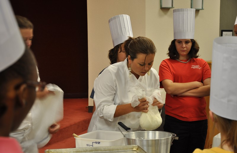 Chef Angela places the mozzarella in the cheesecloth.jpg