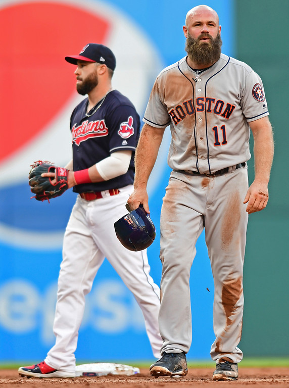 . Houston Astros\' Evan Gattis reacts after being tagged out at second base by Cleveland Indians\' Jason Kipnis during the third inning of a baseball game Friday, May 25, 2018, in Cleveland. (AP Photo/David Dermer)