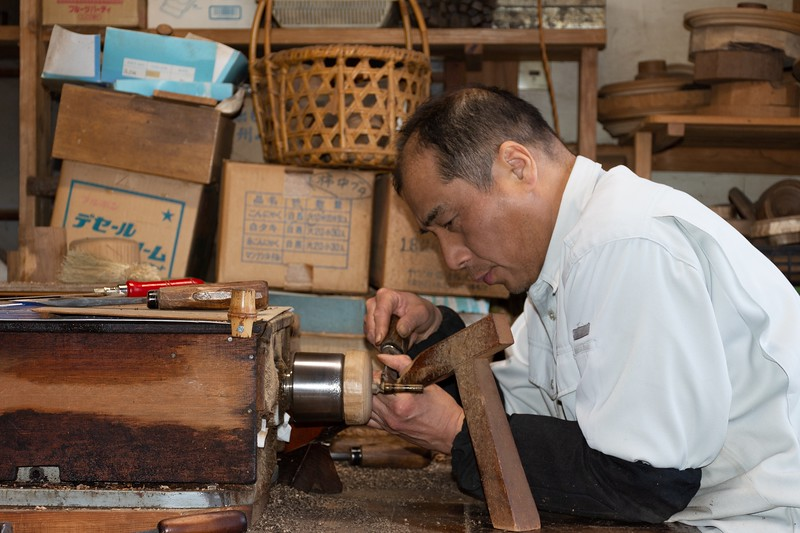 Japanese Man Working on a Wood Lathe