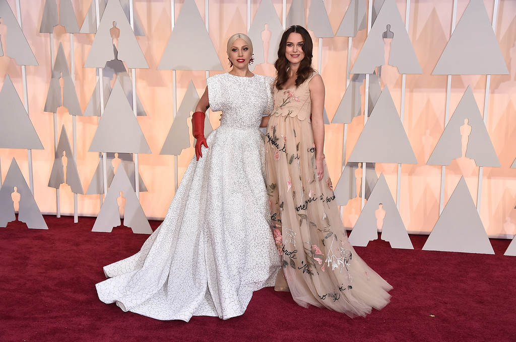 . Lady Gaga, left, and Keira Knightley arrive at the Oscars on Sunday, Feb. 22, 2015, at the Dolby Theatre in Los Angeles. (Photo by Jordan Strauss/Invision/AP)