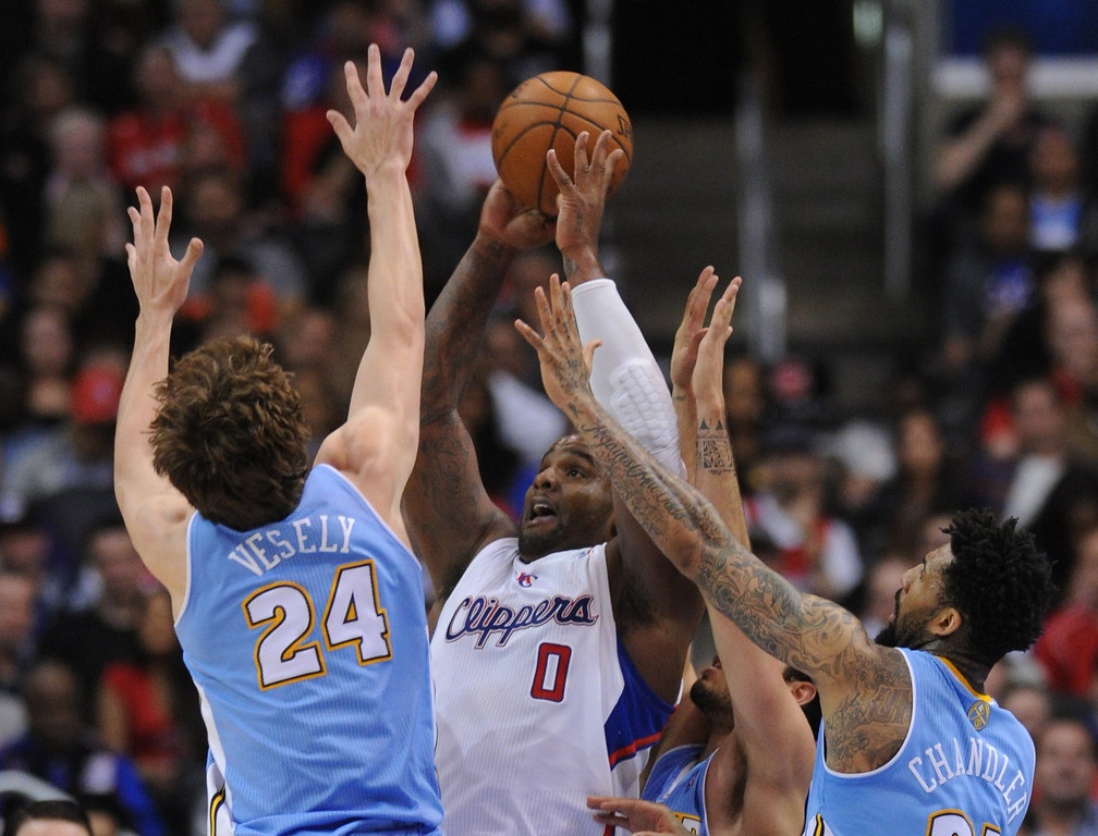 . Clippers#0 Glen Davis gets hammered by Denver#24 Jan Vesely and Denver#21 Wilson Chandler in the second half. The Los Angeles Clippers defeated Denver Nuggets 117 to 105 in a regular season NBA game. Los Angeles, CA. 4/15/2014(Photo by John McCoy / Los Angeles Daily News)
