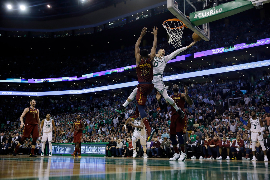 . Boston Celtics forward Jayson Tatum (0) drives to the basket against Cleveland Cavaliers center Tristan Thompson (13) during the second half in Game 2 of the NBA basketball Eastern Conference finals, Tuesday, May 15, 2018, in Boston. (AP Photo/Charles Krupa)