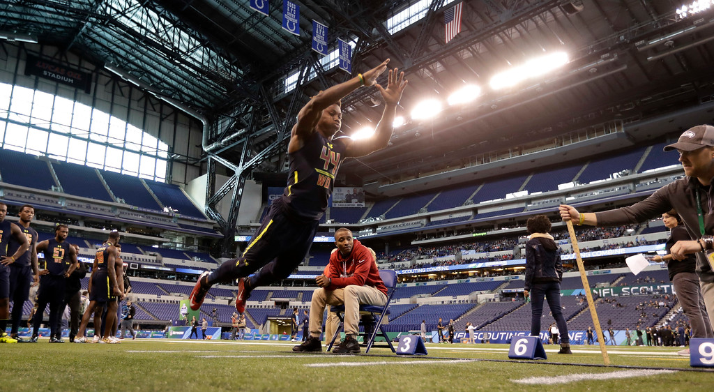 . Ohio State wide receiver Curtis Samuel is tested in the broad jump at the NFL football scouting combine Saturday, March 4, 2017, in Indianapolis. (AP Photo/David J. Phillip)