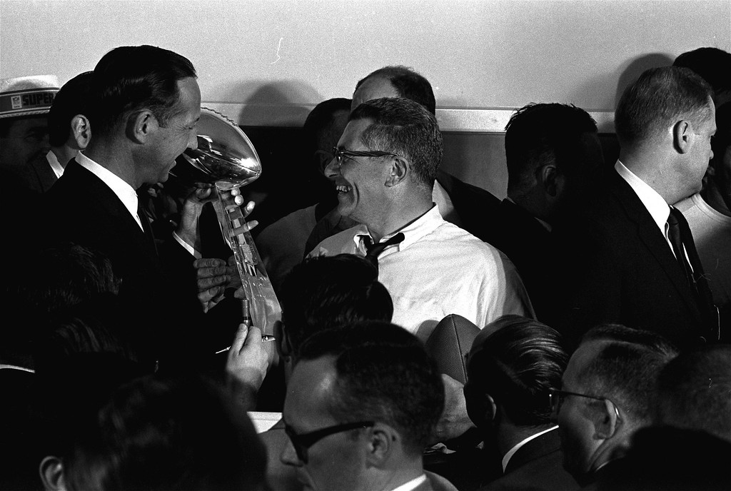 . Football commissioner Pete Rozelle, left, presents the trophy to Coach Vince Lombardi of the Green Bay Packers in Los Angeles January 15, 1967, after the Packers trounced the Kansas City Chiefs 35 to 21 in the first Super Bowl football game.. (AP Photo)