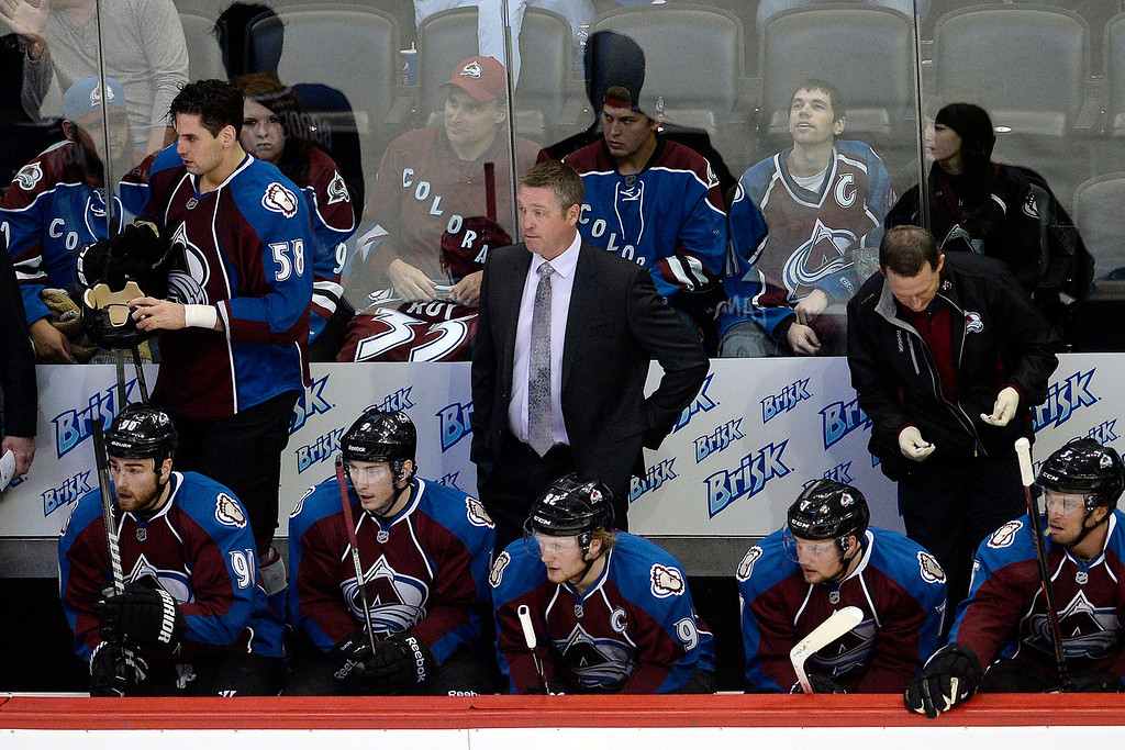 . Head coach Patrick Roy of the Colorado Avalanche watches the action against the Winnipeg Jets during the first period. (Photo by AAron Ontiveroz/The Denver Post)
