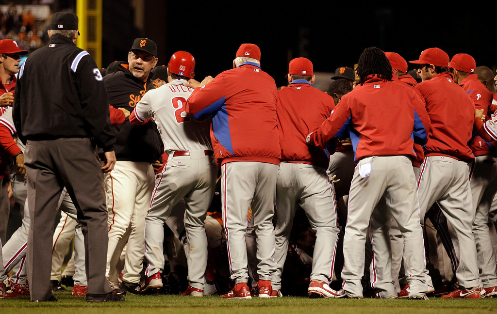 . San Francisco Giants manager Bruce Bochy, second from left, and Philadelphia Phillies\' Chase Utley participate in a benches clearing brawl during the sixth inning of a baseball game Friday, Aug. 5, 2011, in San Francisco. (AP Photo/Ben Margot)