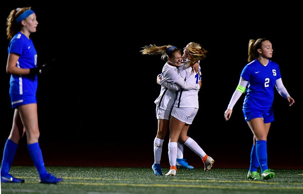 11/23/2019 Mike Orazzi | Staff Glastonbury's Mackenzie Baker (6) and Samantha Forrest (17) celebrate the only goal during the Class LL Girls State Soccer Tournament at Veterans Stadium in New Britain Saturday evening. Glastonbury beat Southington 1-0.