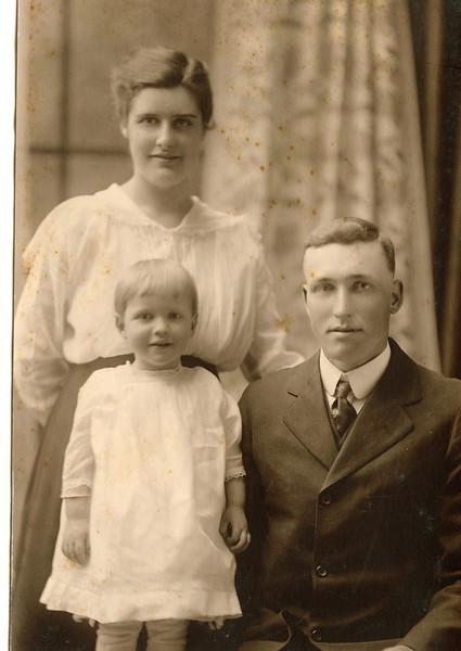 "Margaret Louise Dew (1916-2003), Mabelle Elizabeth (Coursey) Dew (1896-1961),  Byron Elmer Dew (1893-1986)    Written in the Rogers Reunion Photo Album Volume III page 34 ""Mr. and Mrs. Elmer Dew & family. Mabelle, Elmer, Margaret"""