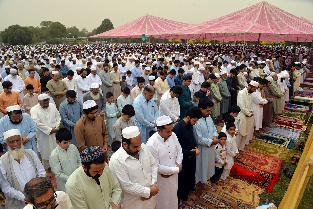 . Pakistani faithful offer Eid al-Fitr prayers to celebrate the end of the holy month of Ramadan in Peshawar, Pakistan, Friday, June 15, 2018. Eid al-Fitr is being celebrated in parts of Khyber-Pakhtunkhwa province on Friday while rest of Pakistan will begin the festivities on Saturday. (AP Photo/Muhammad Sajjad)